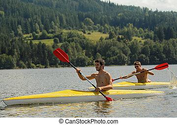 Kayaking sporty men on river sunshine - Young men kayaking...
