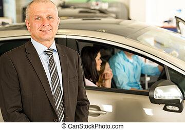 Closeup portrait of car dealer looking at camera