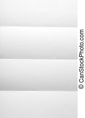 white textured sheet of paper folded in four