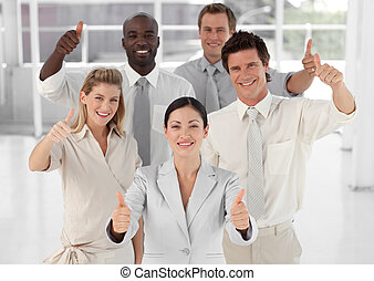 Business Team Smiling and Holding up Thumbs to camera -...
