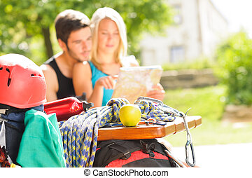 Young couple relax sunny terrace climbing gear - Backpack...