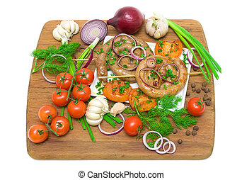 grilled sausages with vegetables on a cutting board isolated on a white background. top view - horizontal photo.