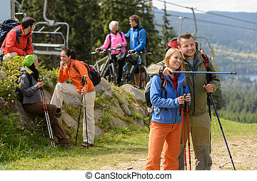 Relaxing hikers and cyclists enjoying view - Young hikers...