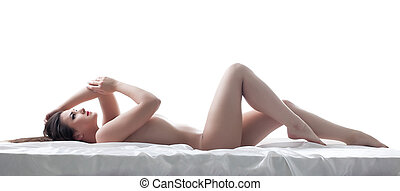 Sexy young brunette posing nude, lying in studio - Image of...