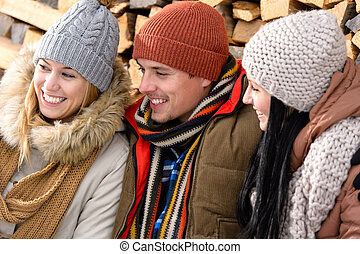 Three friends laughing winter outdoor clothes