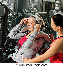 Senior woman exercise with personal trainer - Senior woman...