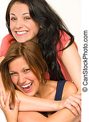 Pretty teens laughing and smiling at camera - Portrait of...
