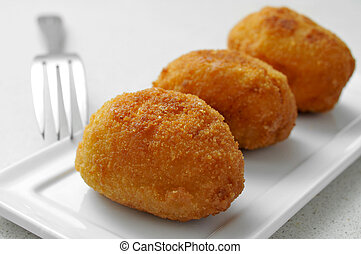 croquetas, spanish croquettes - closeup of a plate with...