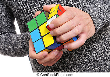 young man and cube puzzle - young man playing trying to...