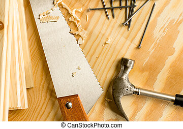 Carpenter tools - Carpenter wood saw, roofing hammer, nails...