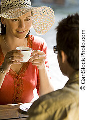 Romantic Coffee - A young couple enjoying a romantic cup of...