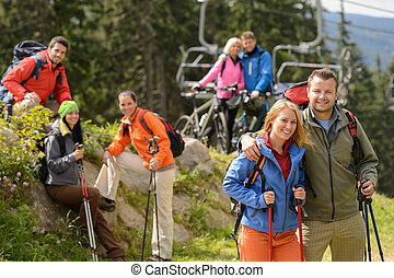 Hikers and cyclists on summer vacation - Smiling hikers and...