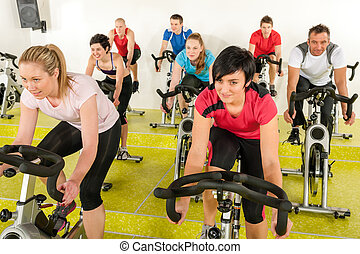 Spinning class people at the fitness center - Spinning class...