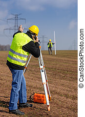 Geodesist measure land speak transmitter - Land surveyors...