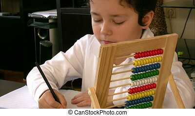 Student counting  with abacus - Student using an abacus
