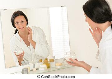 Woman facial mirror reflection in bathroom - Woman looking...