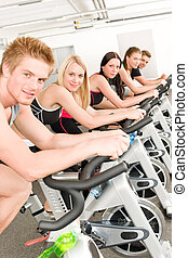 Fitness group of people on gym bike - Fitness group of...