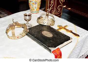 Ancient holy bible on old altar.