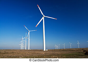 Wind power generators with blue clear sky