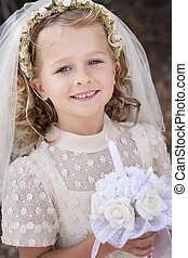 Gril Holy communion - A young child doing her first holy...