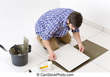 Home improvement - handyman laying tile - Home improvement,...