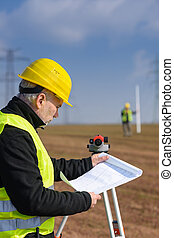 Geodesist male look land plans measure theodolite - Land...