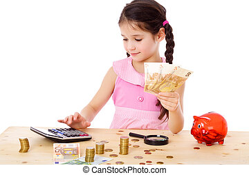 Girl at the table counts money - Little girl at the table...