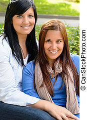 Mother and daughter spending free time outdoors teen family...