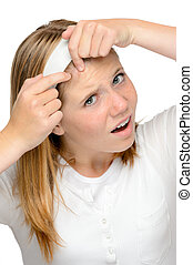 Teenager girl squeezing pimple skin problems spot