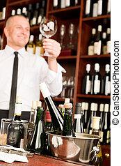 Wine bar waiter clean glass in restaurant