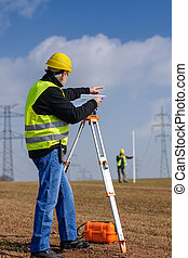 Geodesist measure land point direction - Land surveyors...