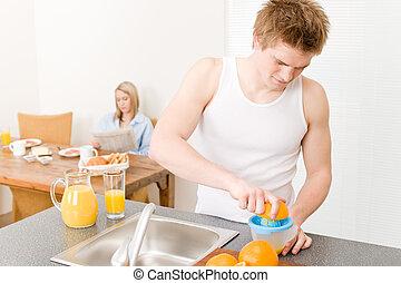 Breakfast happy couple make orange juice morning - Breakfast...