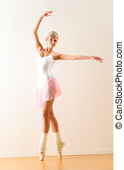 Beautiful ballet dancer practicing dance posture - Ballet...