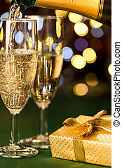 Glasses of champagne and present special occasion - Glasses...