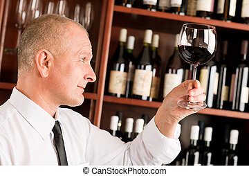 Wine bar waiter looking at glass restaurant