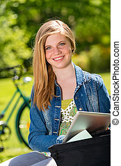 Student girl studying with tablet outside - Student girl...