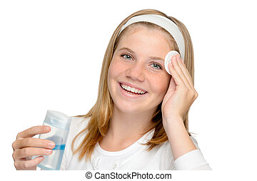 Young cheerful girl removing make-up cleansing pad cleaning...
