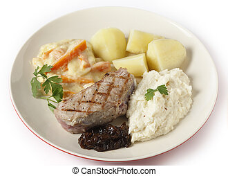 Veal steak with gourmet vegetables side view - Veal sirloin...