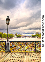Love padlocks on Pont des Arts bridge, Seine river in Paris....