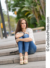 Young woman, wearing casual clothes, with long hair -...