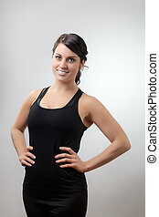 Beautiful young girl - gym girl standing looking at the...