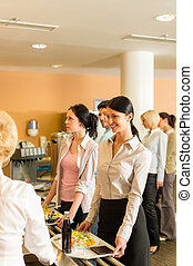 Cafeteria pay at cashier women in queue - Cafeteria woman...
