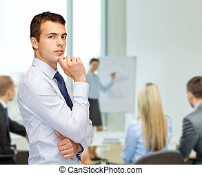 pensive young buisnessman at office - business and office,...
