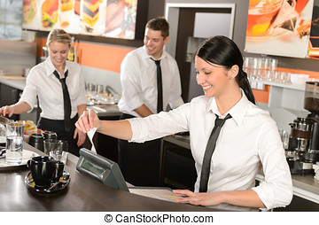 Female cashier giving receipt working in cafe - Female...