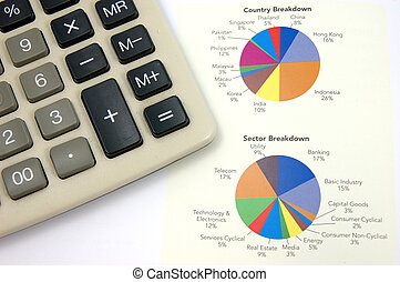 Pie chart and calculator - Close up of pie chart and...