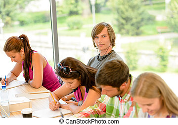 High-school students at lesson in class teens college...