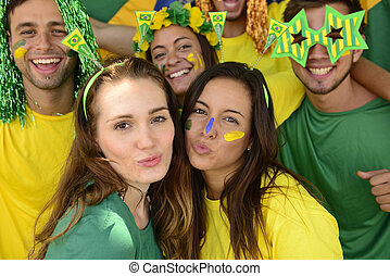 Brazilian soccer fans commemorating victory kissing. - Group...