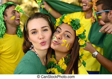 Brazilian girls soccer fans commemorating victory - Group of...