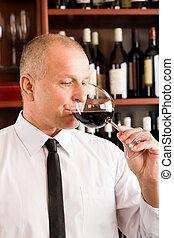 Bar waiter taste glass red wine restaurant - Waiter at bar...