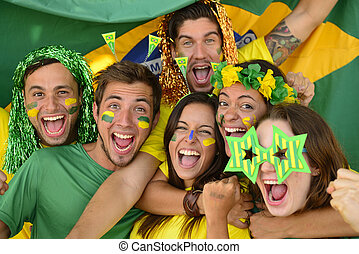 Happy group of Brazilian sport soccer fans amazed...